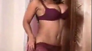 Sexual Indian Angela Devi with big titties tries on her smallest bikinis