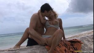Nasty bikini slut Ksenia deepthroating at the beach
