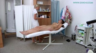 Ellie Springlare at the doctors office pokes a dildo in the pussy