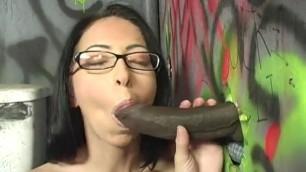 Dark haired Latin girl is sucking a huge black dick