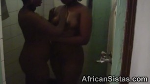 Amateur Raunchy African lesbians having fun in the bathroom