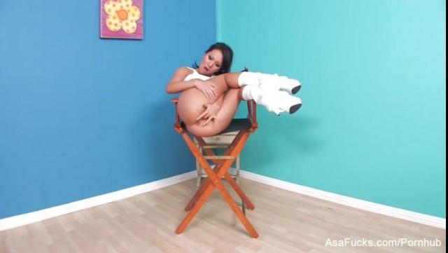 Asa Akira fingers both her holes