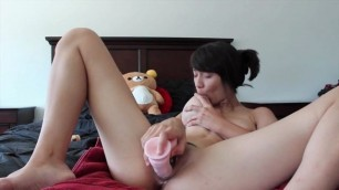 Asian mix creams her pussy with inflatable dildo