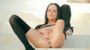 Melanie showcasing her toy and vagina