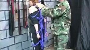 Thick brunette bdsm slave gets ropes around her neck and