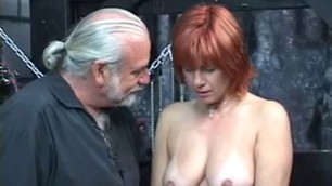 Mature redheaded slave with saggy tits is whipped in twinks fucking