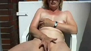 Woman masturbates on the balcony pregnant tits