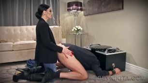 A depraved brunette puts a man on his knees and fucks a huge dildo